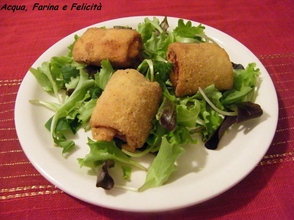 rotolini di pancarrè con prosciutto cotto e formaggio filante